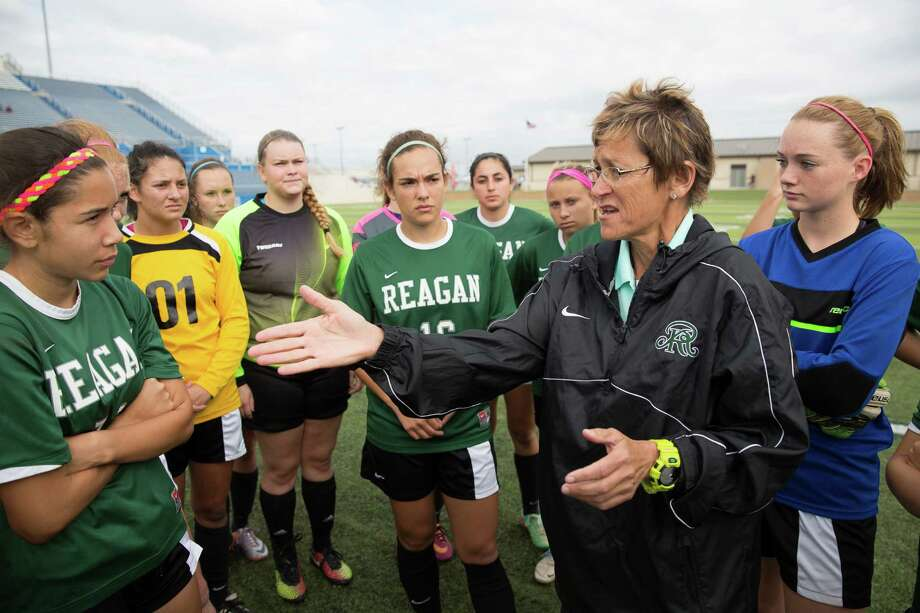 San Antonio Reagan head coach Frankie Whitlock, right, talks to the team before their 6A semi-final match against Coppell. Reagan lost to Coppell 0-1 during the 6A Girls Soccer Semi-Final in Georgetown on Friday April 17, 2015. Julia Robinson/For the Express-News Photo: Julia Robinson/For The Express-N / Julia Robinson 2014