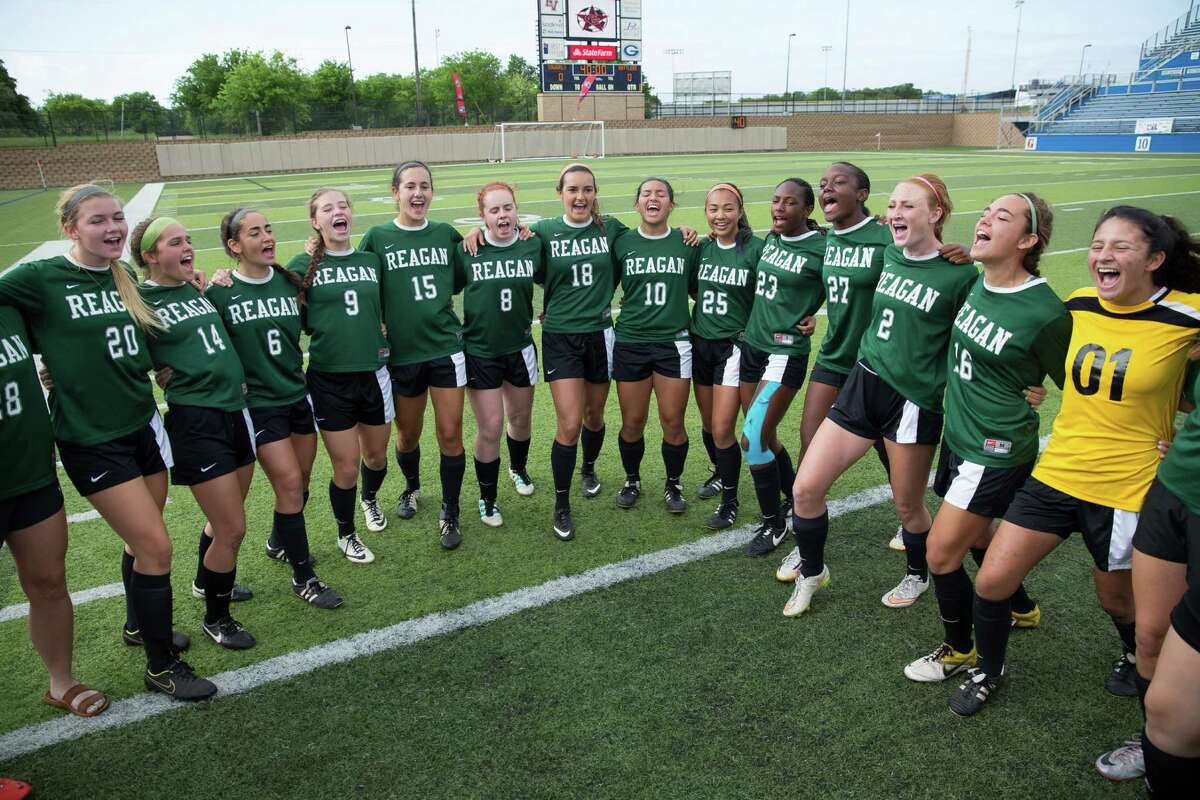 The Reagan girls soccer team cheers before their 6A semifinal game against Coppell in Georgetown on April 17, 2015.