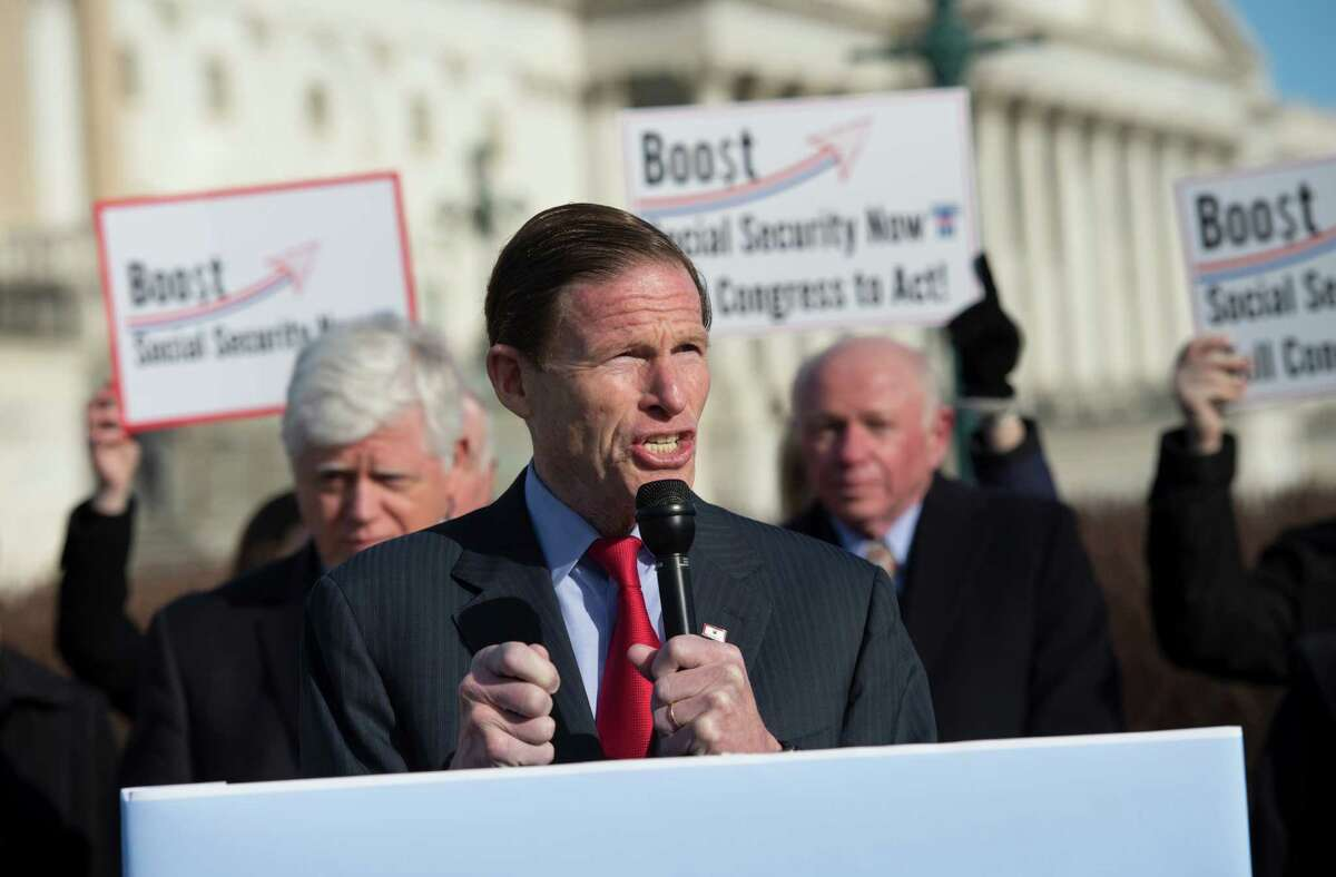Sen. Richard Blumenthal, D-Conn., center, flanked by Rep. John Larson, D-Conn., left, and National Committee to Preserve Social Security & Medicare, President and CEO Max Richtman, speaks during a news conference on Capitol Hill in Washington, Wednesday, March 18, 2105, to announcement of the introduction of the Social Security 2100 Act.