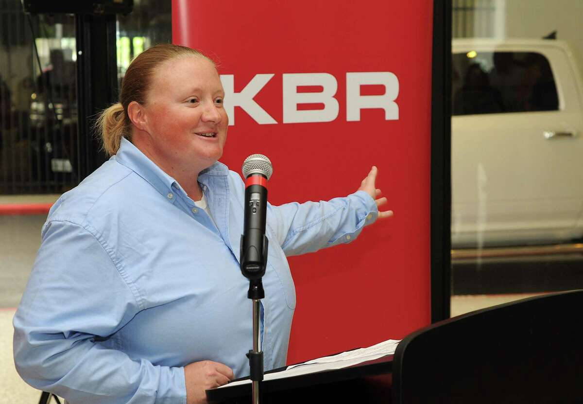 KBR welder Holley Thomas gives her thanks after being named Craft Professional of the Year at the KBR Building Thursday April 16, 2015. Thomas received an new Dodge Ram 1500 for the accomplishment.(Dave Rossman photo)