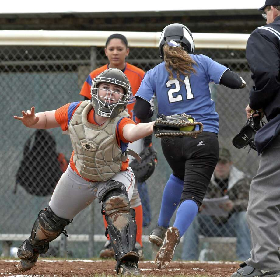 Danbury catcher Alyna Bellantoni (15) reaches for the throw to home as Darien's Erika Osherow (21) crosses the plate to score a run in the girls high school softball game between Darien and Danbury high schools, on Friday, April 17, 2015, played at Danbury High School, Danbury, Conn. Photo: H John Voorhees III / The News-Times
