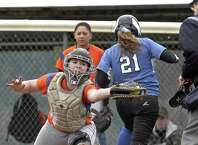 Danbury catcher Alyna Bellantoni (15) reaches for the throw to home as Darien's Erika Osherow (21) crosses the plate to score a run in the girls high school softball game between Darien and Danbury high schools, on Friday, April 17, 2015, played at Danbury High School, Danbury, Conn.