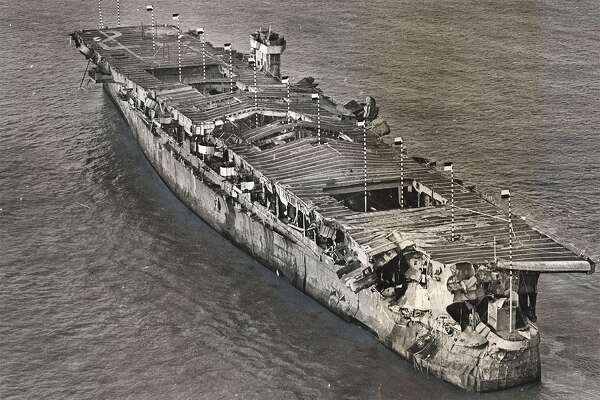 An aerial view of ex-USS Independence at anchor in San Francisco Bay, California, January 1951. There is visible damage from the atomic bomb tests at Bikini Atoll. The ship, which was scuttled in the waters off the Farallon Islands, was recently located by scientists from the National Oceanic and Atmospheric Administration.