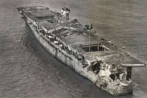 An aerial view of the Independence at anchor in San Francisco Bay in 1951. There is visible damage from the atomic bomb tests at Bikini Atoll. The ship, which was scuttled in the waters off the Farallon Islands, was recently located by scientists from the National Oceanic and Atmospheric Administration.