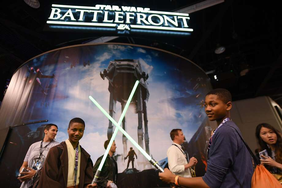 "Fans play with lightsabers at ""Star Wars"" Celebration: The Ultimate Fan Experience the Anaheim Convention Center last week. Photo: Richard Shotwell, Associated Press"