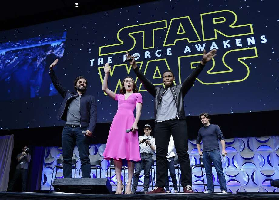 "Cast members (Left to right) Oscar Isaac, Daisy Ridley, John Boyega of ""Star Wars: The Force Awakens"" and back row (Left to right) writer, director and producer J.J. Abrams, producer Kathleen Kennedy and host Anthony Breznican, Entertainment Weekly reporter, acknowledge fans at the kick-off event during Disney's Star Wars Celebration 2015 at the Anaheim Convention Center April 16, 2015. The Star Wars Celebration runs through April 19.  Photo: Kevork Djansezian, Getty Images"