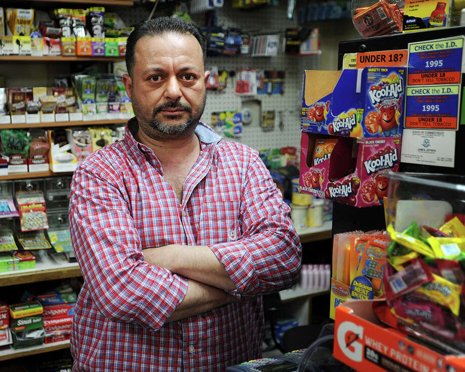 Haidar Arar, of Trumbull, has owned and run Marina Market for nine years at 1056 Reservoir Avenue in Bridgeport, Conn. on Thursday, April 16, 2015. Arar said he is always nervous when working, and is concerned over recent murders of store owners and workers. Photo: Brian A. Pounds / Connecticut Post