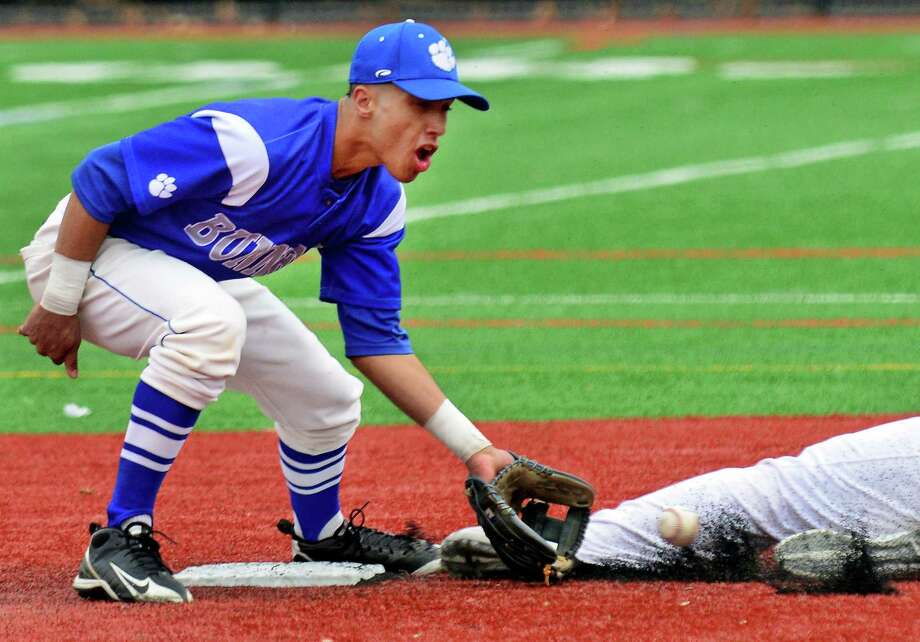 Bunnell's Aaron Rios looks to tag out Stratford's Sam Breiner at second, during baseball action in Stratford, Conn. on Friday Apr. 17, 2015. Photo: Christian Abraham / Connecticut Post