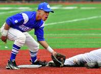 Bunnell's Aaron Rios looks to tag out Stratford's Sam Breiner at second, during baseball action in Stratford, Conn. on Friday Apr. 17, 2015.