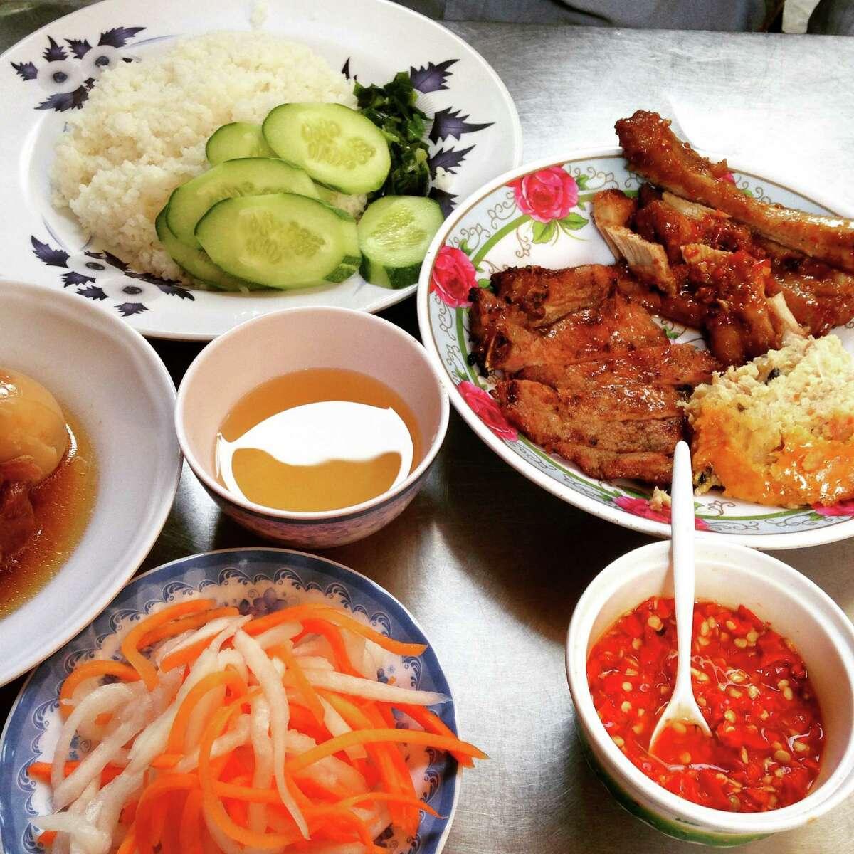 Pork chops and broken rice at Com Tam Tran Quy Cap in Ho Chi Minh City, Vietnam