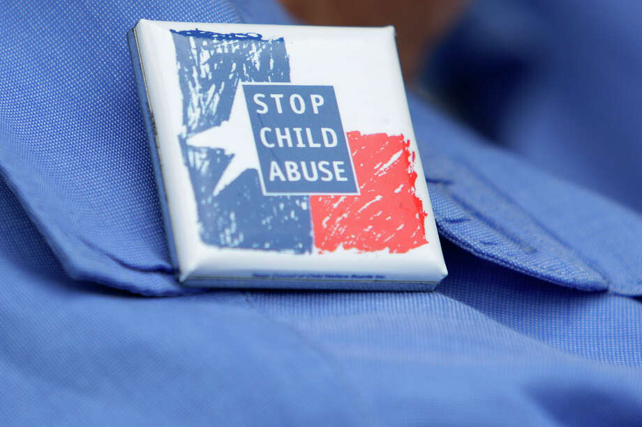 This file photo shows a participant's pin at a Texas CASA, Court Appointed Special Advocates, rally in front of the Bexar County Courthouse. Photo: JERRY LARA /San Antonio Express-News / glara@express-news.net