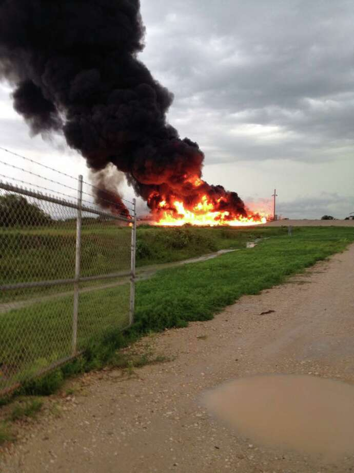 A large explosion occurred Friday afternoon at an oil facility north of Karnes City that sent flames more than a hundred feet into the air, the Karnes County Sheriff's Office confirmed. Photo: Karnes County Sheriff's Office