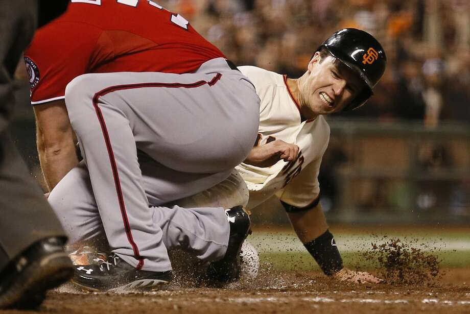 Buster Posey attempting (and failing) to score during NLDS Game 4 Photo: Beck Diefenbach