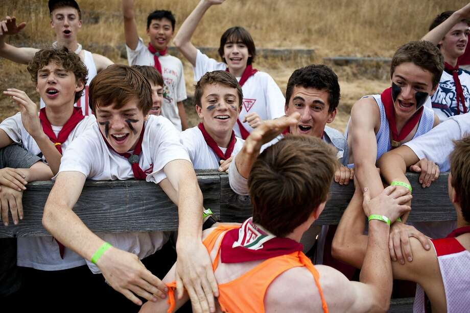 Celebrating a tug-of-war win at Camp Royaneh in 2014 Photo: Beck Diefenbach