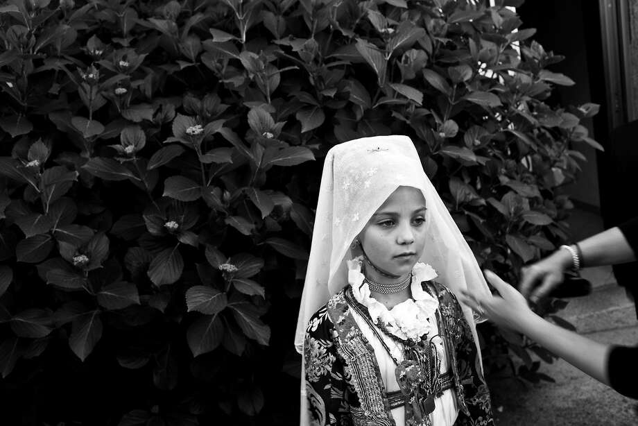 Flower girl get's prepared on the the Island of Sardinia in 2010 Photo: Beck Diefenbach