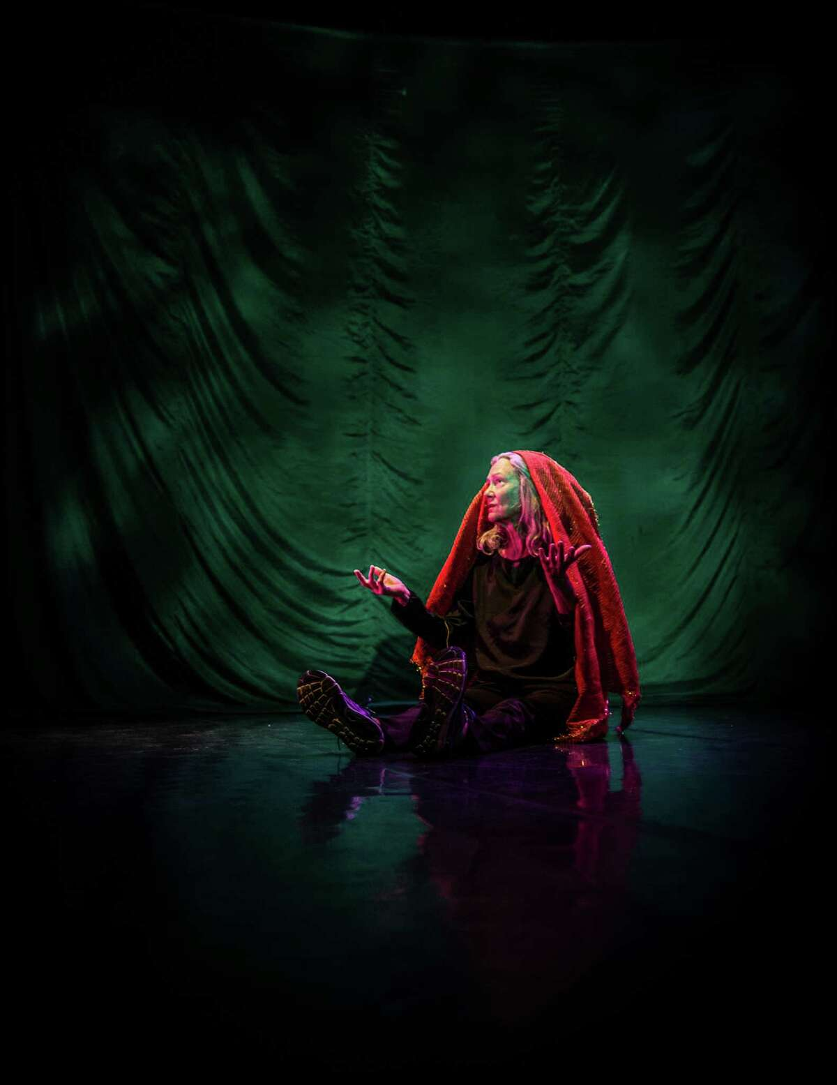 Sara Shelton Mann performs solo in her autobiographical work,