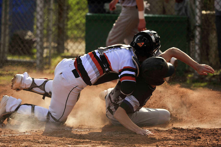 Stamford catcher Tyler Serricchio tags Michael Tufano out at home plate during their baseball game at Stamford High School in Stamford, Conn., on Friday, April 17, 2015. Westhill won, 3-0. Photo: Jason Rearick / Stamford Advocate
