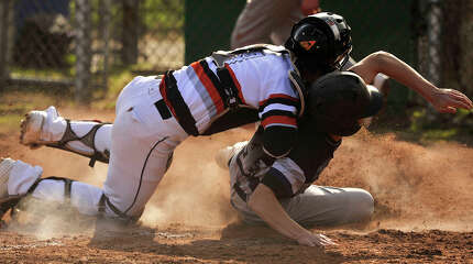Stamford catcher Tyler Serricchio tags Michael Tufano out at home plate during their baseball game at Stamford High School in Stamford, Conn., on Friday, April 17, 2015. Westhill won, 3-0.