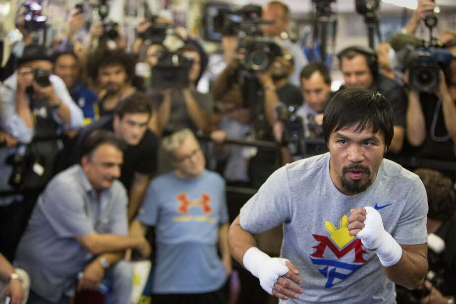 **EDS: RETRANSMISSION OF XNYT34 SENT APRIL 17, 2015 TO CORRECT SPELLING OF PACQUIAO STED PACQUAIO.** Manny Pacquiao works out in front of  reporters at the Wild Card Boxing Club in Los Angeles, April 15, 2015.  Pacquiao's bout with Floyd Mayweather Jr. on May 2 will be the richest in history, but regardless of the complicated logistics of the split — 60/40 in Mayweather's favor — both men should make well over $100 million. (Monica Almeida/The New York Times) Photo: Monica Almeida, New York Times