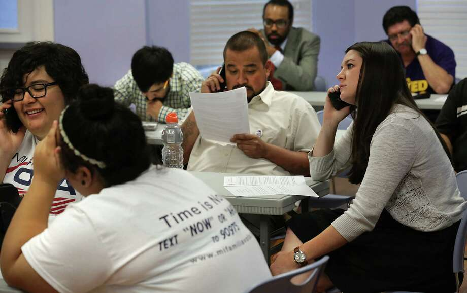 Erica Wadzinski, right, and other workers for Mi Familia Vota-San Antonio and Service Employees International Union, conduct a phone bank to urge Governor Greg Abbot and Attorney General Ken Paxton to drop legal action against the President's immigrant plan.  April 17, 2015. Photo: Bob Owen, Staff / San Antonio Express-News / © 2015 San Antonio Express-News