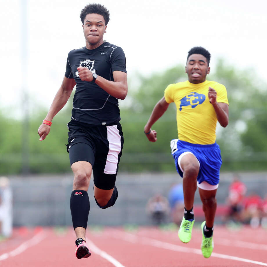 Steele's Andrew Hudson (left) approaches the finsih line of the 100-meter dash ahead of Clemens' Devante Carmona during the finals of the running events in the District 25-6A track and field meet at Rutledge Stadium on Friday, April 17, 2015.  Hudson finished third in the event with a time of 10.89 seconds.  MARVIN PFEIFFER/ mpfeiffer@express-news.net Photo: Marvin Pfeiffer, Staff / San Antonio Express-News / Express-News 2015