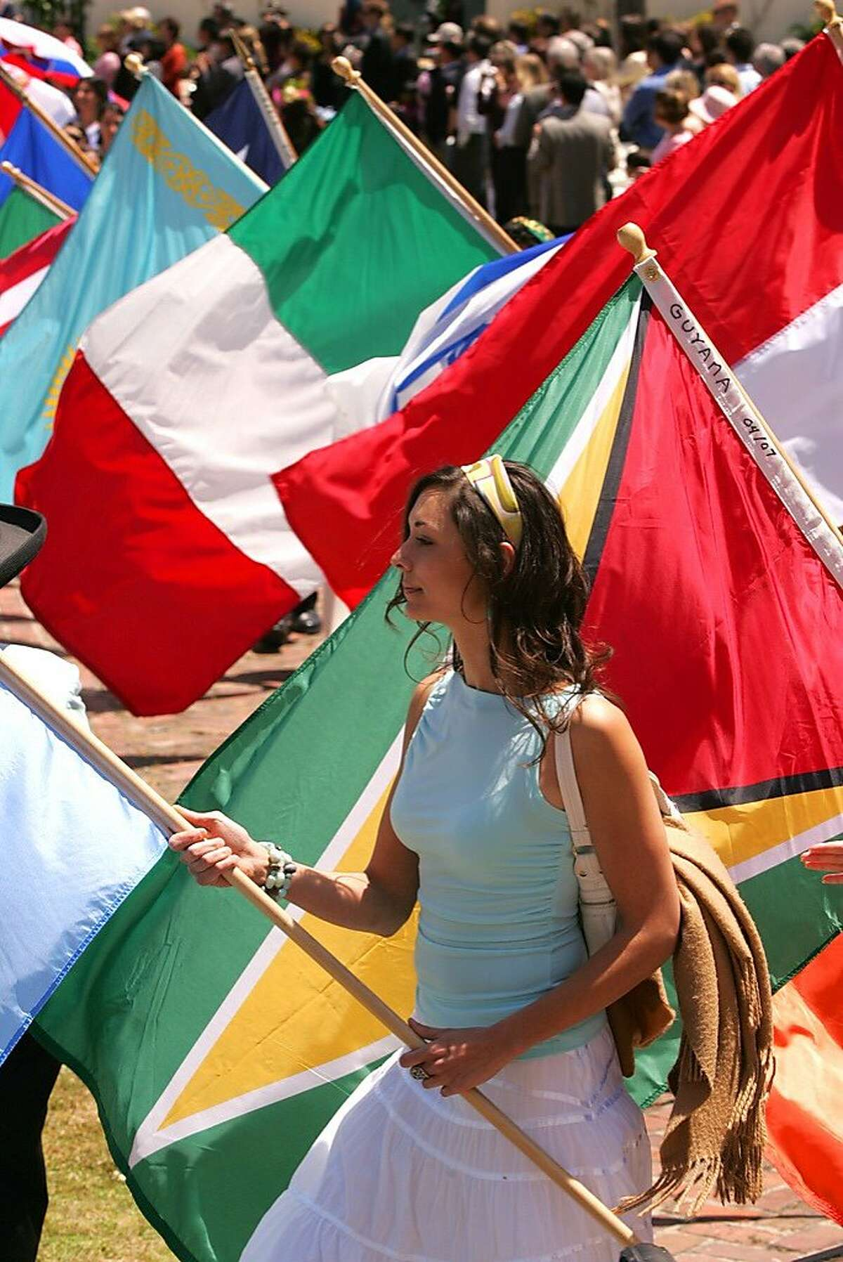 A participant carries one of the flags on display for the Language Capital of the World Cultural Festival on May 2 in Monterey.