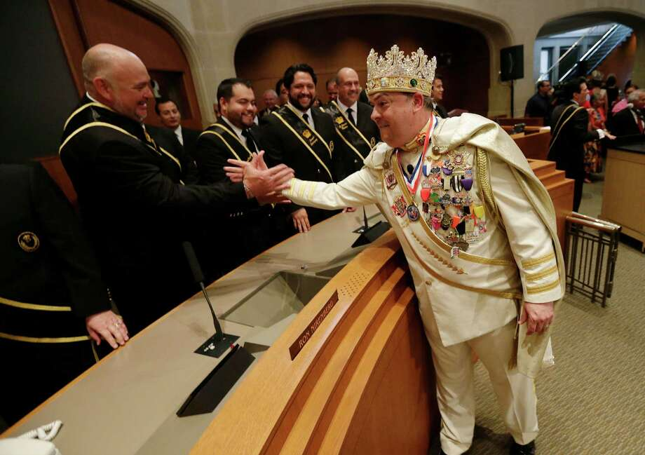 Rey Feo LXVII, Jon Gary Herrera, shakes hands with his newly appointed staff after his crowning ceremony at City Council Chambers on Friday, Apr. 17, 2015. Photo: Kin Man Hui, San Antonio Express-News / ©2015 San Antonio Express-News