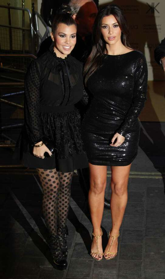 Kim, right, and Kourtney Kardashian arrive for their Kardashian Kollection UK Launch at Acqua Club in central London, Thursday, Nov. 8, 2012. (Photo by Joel Ryan/Invision/AP) Photo: Joel Ryan / Invision