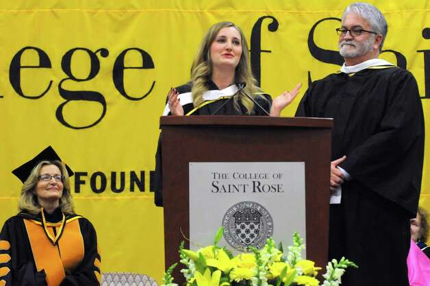 Carolyn J. Stefanco, left, listens as her daughter Alexandra Stefanco Gordon speaks during the official Inauguration of Stefanco as 11th president of The College of Saint Rose on Friday April 17, 2015 in Albany, N.Y. Stefanco's husband McGuire Gordon is to the right. (Michael P. Farrell/Times Union) Photo: Michael P. Farrell / 00031378A