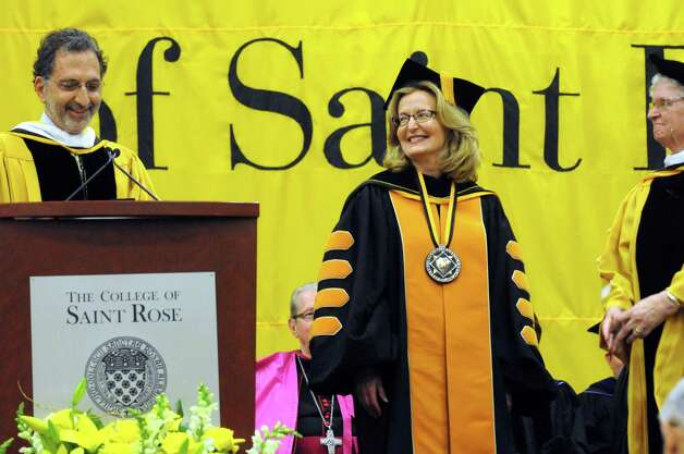 Trustee I. Norman Massry, left, completes the official Inauguration of Carolyn J. Stefanco as 11th president of The College of Saint Rose on Friday April 17, 2015 in Albany, N.Y. (Michael P. Farrell/Times Union) Photo: Michael P. Farrell / 00031378A