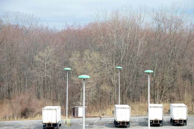 View of the wooded lot adjacent to the Times Union parking area and Northway is being considered for retail development Friday, April 17, 2015, in Colonie, N.Y. The Times Union owns 30 acres of land at the Albany Shaker Rd property which runs alongside I-87. (Will Waldron/Times Union) Photo: WW
