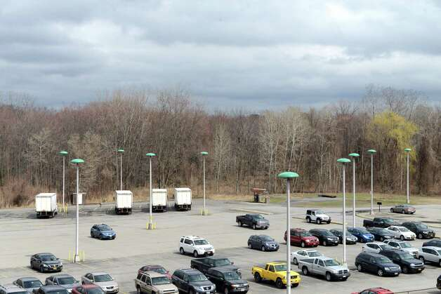 View of the wooded lot adjacent to the Times Union parking area and Northway is being considered for retail development Friday, April 17, 2015, in Colonie, N.Y. The Times Union owns a large parcel of land at the Albany Shaker Rd property which runs alongside I-87. (Will Waldron/Times Union) Photo: WW