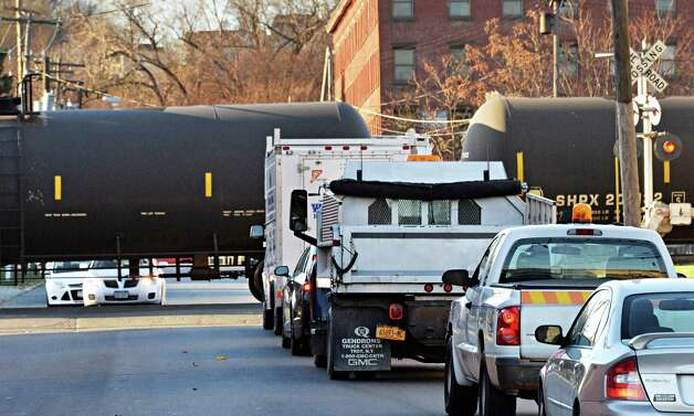 Traffic backs up on N. Ferry St. as a train moving oil tank cars passes Friday Nov. 21, 2014, in Albany, NY. (John Carl D'Annibale / Times Union)