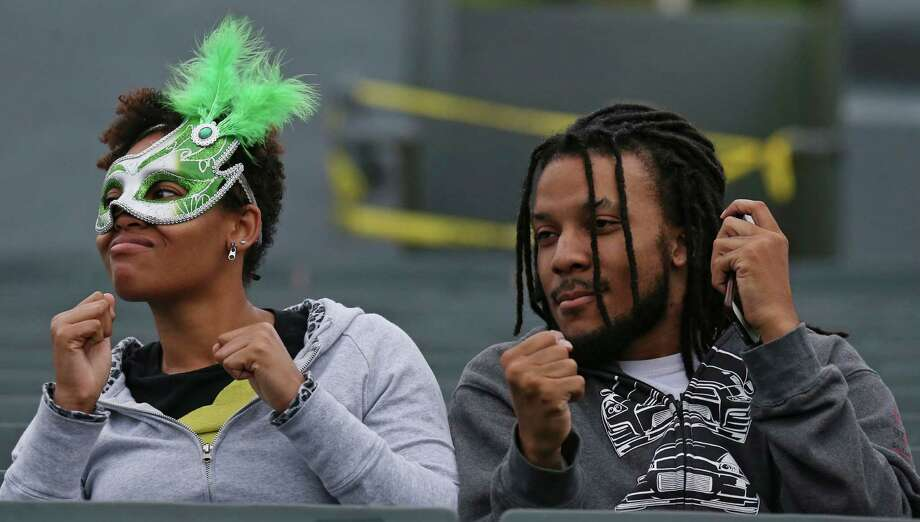 Leslie McQueen (left) and Justin McKinney take in the sights while listing to music during a Taste of New Orleans Friday April 17, 2015 at Sunken Garden Theater. Taste of New Orleans runs April 17-April 19 at Sunken Garden Theater. Photo: Edward A. Ornelas, Staff / San Antonio Express-News / © 2015 San Antonio Express-News