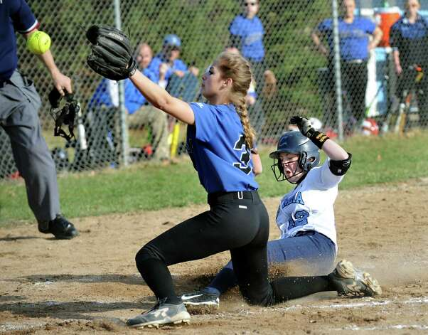 Columbia's Matti Hayes, right, slides safely into home on a wild pitch as Saratoga's Kayleigh Reome covers the base during their softball game on Friday, April 17, 2015, at Columbia High in East Greenbush, N.Y. (Cindy Schultz / Times Union) Photo: Cindy Schultz / 00031476A