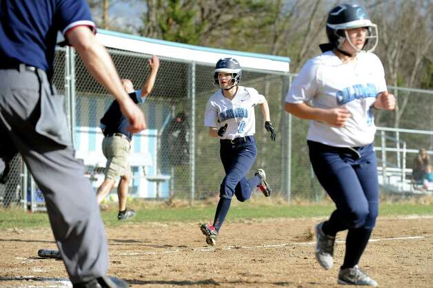 Columbia's Sammy Hart, center, runs for home behind Kati Hayes, right, during their softball game against Saratoga on Friday, April 17, 2015, at Columbia High in East Greenbush, N.Y. (Cindy Schultz / Times Union) Photo: Cindy Schultz / 00031476A