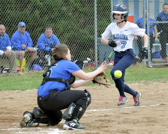 Columbia's Sammy Hart, right, tries to beat the ball home as Saratoga's Cassidy Hayner readies for the out during their softball game on Friday, April 17, 2015, at Columbia High in East Greenbush, N.Y. (Cindy Schultz / Times Union) Photo: Cindy Schultz / 00031476A