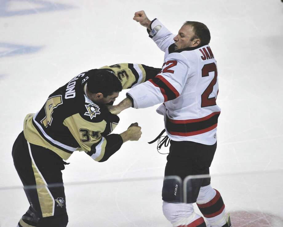 The Penguins' Pierre-Luc Letourneau-Leblond, left, and Devils' Cam Janssen duke it out in the first period of Friday's AHL hockey game at Mohegan Sun Arena. (Pete G. Wilcox|Times Leader) Photo: PETE G. WILCOX / WILKES-BARRE TIMES LEADER