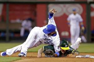 Alcides Escobar (left) injures his knee when he's knocked down by a sliding Brett Lawrie on a seventh-inning forceout.