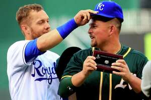 A's Billy Butler honored at old home, then plays peacemaker - Photo