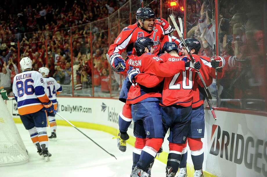 WASHINGTON, DC - APRIL 17: Nicklas Backstrom #19 of the Washington Capitals celebrates with teammates after scoring in the third period against the New York Islanders during Game Two of the Eastern Conference Quarterfinals during the 2015 NHL Stanley Cup Playoffs at Verizon Center on April 17, 2015 in Washington, DC. Washington won the game 4-3. (Photo by Greg Fiume/Getty Images) ORG XMIT: 548283383 Photo: Greg Fiume / 2015 Getty Images