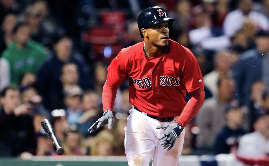 Boston Red Sox's Xander Bogaerts watches his game-winning single, which drove in teammate Mike Napoli to break a 2-2 tie, during the ninth inning of a baseball game against the Baltimore Orioles at Fenway Park in Boston, Friday, April 17, 2015. The Red Sox won 3-2. (AP Photo/Charles Krupa) ORG XMIT: MACK118 Photo: Charles Krupa / AP
