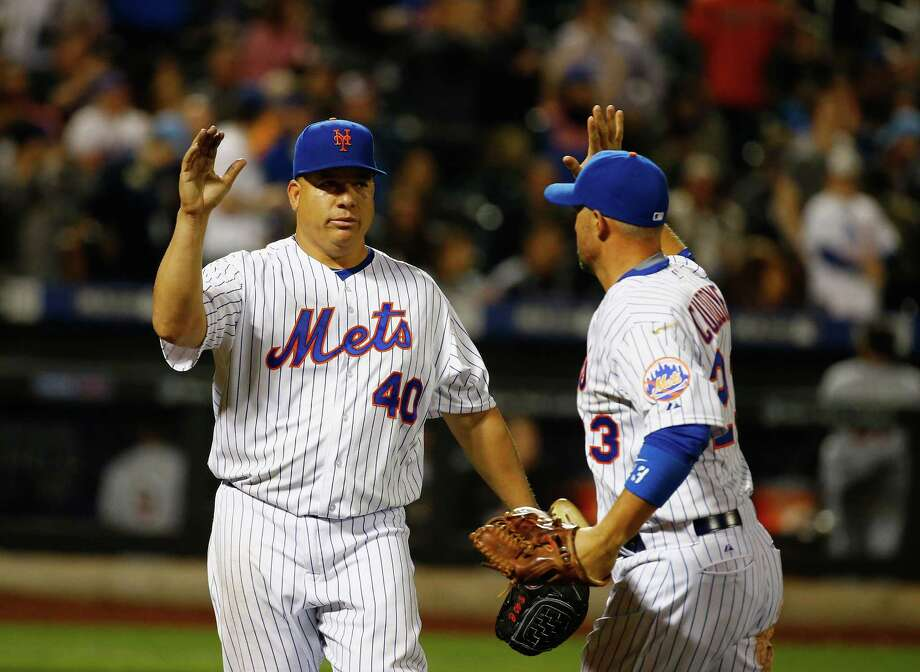NEW YORK, NY - APRIL 17:  Bartolo Colon #40 of the New York Mets celebrates retiring the side with Michael Cuddyer #23 in the sventh inning against the Miami Marlins during their game at Citi Field on April 17, 2015 in New York City.  (Photo by Al Bello/Getty Images) ORG XMIT: 538577611 Photo: Al Bello / 2015 Getty Images