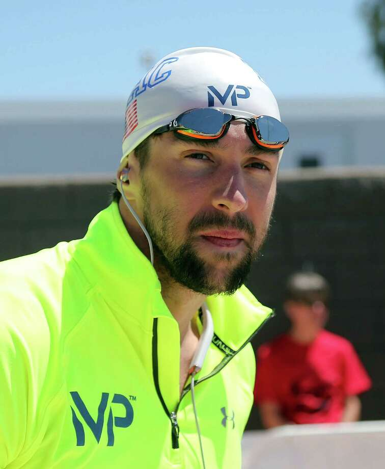 MESA, AZ - APRIL 17:  Michael Phelps watches a race before competing in the 400m Freestyle Prelim during day three of the Arena Pro Swim Series at the Skyline Acquatic Center on April 17, 2015 in Mesa, Arizona.  (Photo by Chris Coduto/Getty Images) ORG XMIT: 537309127 Photo: Chris Coduto / 2015 Getty Images
