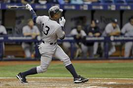 New York Yankees' Alex Rodriguez follows the flight of his two-run home run off Tampa Bay Rays relief pitcher Ernesto Frieri during the sixth inning of a baseball game Friday, April 17, 2015, in St. Petersburg, Fla. (AP Photo/Chris O'Meara)