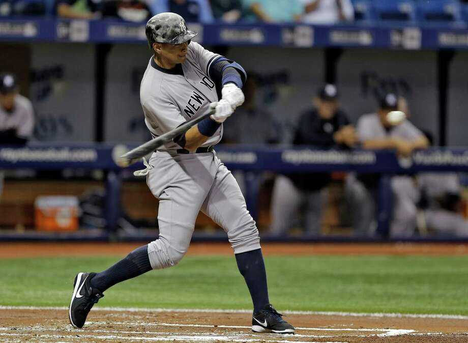 New York Yankees' Alex Rodriguez starts his swing on a home run off Tampa Bay Rays starting pitcher Nathan Karns during the second inning of a baseball game Friday, April 17, 2015, in St. Petersburg, Fla. (AP Photo/Chris O'Meara)  ORG XMIT: SPD101 Photo: Chris O'Meara / AP