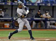 New York Yankees' Alex Rodriguez starts his swing on a home run off Tampa Bay Rays starting pitcher Nathan Karns during the second inning of a baseball game Friday, April 17, 2015, in St. Petersburg, Fla. (AP Photo/Chris O'Meara)  ORG XMIT: SPD101