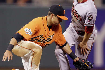 A.J. Pollock beats the tag by Joe Panik on a steal, one of many things that went right for Arizona.