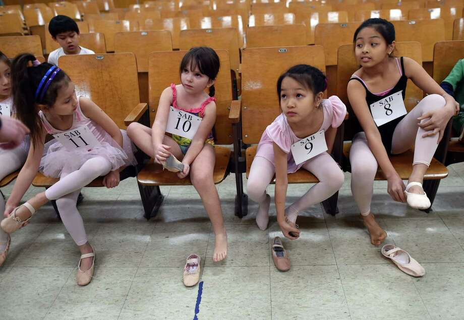 (L-R): Young ballet dancers Eliana Hinds-Fernandez, Amalia Locker-Olesker, Natalie Ng and Renee Ng prepare for auditioning as boys and girls ages 6 to 7 try out for The School of American Ballet Winter Term  at the P.S. 124 Yung Wing school in New York's Chinatown on April 16, 2015.  The School of American Ballet  was established in 1934  and is one of the premier ballet academies in the United States. Photo: TIMOTHY A. CLARY, AFP / Getty Images / AFP