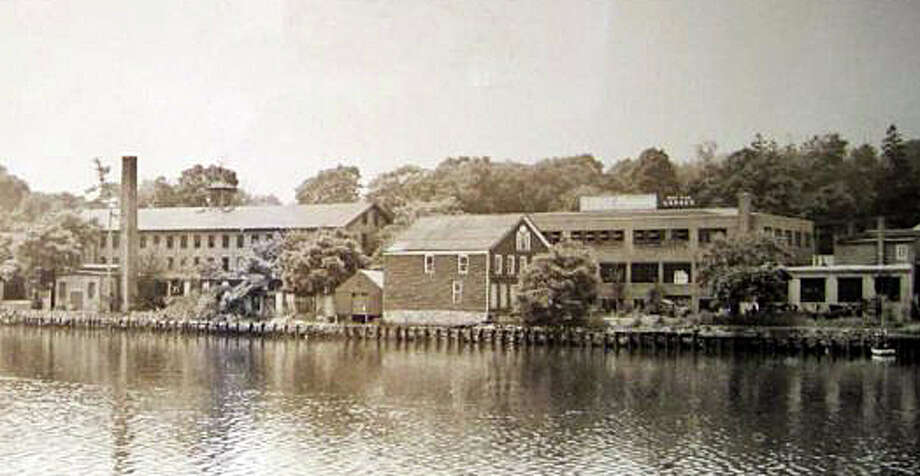 A 1920s-era view of the Gault and Son buildings overlooking the Saugatuck River. Photo: Contributed Photo / Westport News